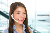 Headset customer service woman at call center — Stock Photo
