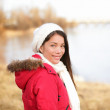 Fall woman enjoying late autumn, winter at lake — Stock Photo