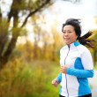 Active woman in her 50s running and jogging — Stock Photo #29500293