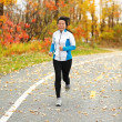 Middle aged Asian woman running active in her 50s — Stock Photo