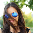 Sunglasses woman funky portrait outdoor — Stock Photo #29500317