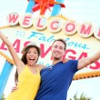 Las vegas people - couple happy cheering by sign — Stock Photo #29500551