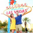 Las Vegas Sign - couple jumping having fun — Stock Photo #29500561