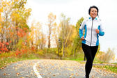 Mature Asian woman running active in her 50s — Stock Photo
