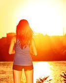 Woman enjoying sunset sunshine after running — Stock Photo