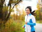 Active woman in her 50s running and jogging — Stock Photo