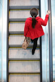 Urban people - woman commuter walking on escalator — Stok fotoğraf