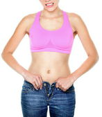 Weight gain and weight loss woman buttoning pants — Stock Photo