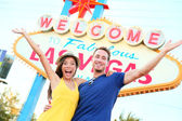 Las vegas people - couple happy cheering by sign — Stock Photo