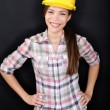 Construction worker or engineer portrait on black — Stock Photo