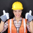 Construction worker thumbs up happy woman portrait — Stock Photo