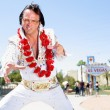 Stock Photo: Elvis impersonator dancing by Las Vegas sign