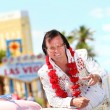 Elvis impersonator and Las Vegas sign — Stock Photo
