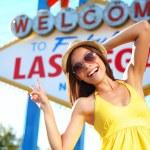 Tourist woman in Las Vegas sign posing happy — Stock Photo