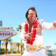 Stock Photo: Elvis look-alike impersonator and Las Vegas sign