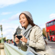 London tourist woman sightseeing taking pictures — Stock Photo