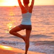 Yoga meditation woman meditating at beach sunset — Stock Photo
