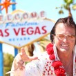 Stock Photo: Elvis impersonator min front of Las Vegas sign