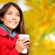Coffee woman drinking coffee outside in fall — Stock Photo