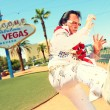 Elvis look-alike impersonator and Las Vegas sign — Stock Photo #31779101