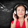 Music - woman wearing headphones listening to music — Stock Photo