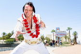 Elvis impersonator dancing by Las Vegas sign — Stock Photo