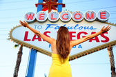 Welcome to Fabulous Las Vegas sign woman happy — Stock Photo