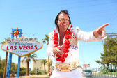 Elvis look-alike impersonator and Las Vegas sign — Stock Photo