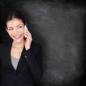 Smart phone blackboard - woman on mobile phone — Stock Photo