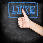 Like - likes thumbs up on blackboard — Stock Photo