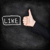 Like - likes thumbs up on chalkboard — Stock Photo