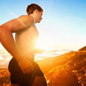 Running people - male runner at sunset in mountain — Stock Photo