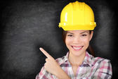 Female construction worker or engineer showing — Stock Photo