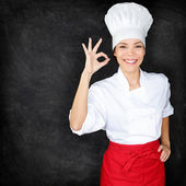 Chef showing Perfect hand sign and menu blackboard — Stock Photo