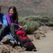 Stock Video: Hikers couple resting hiking on Teide