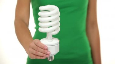 Energy saver light bulb - woman showing — Stock Video