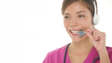 Medical nurse doctor headset call center hotline secretary — Stock Video