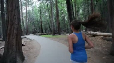 Running - woman runner on forest path in Yosemite — Stock Video