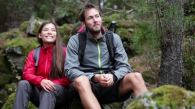 Young people hikers having fun outdoors in forest. Multiracial couple Asian woman and Caucasian man. From La Caldera Aguamansa La Orotava, Tenerife, The Canary Islands, Spain