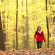 Autumn woman happy walking in fall forest — Stock Video #32379041