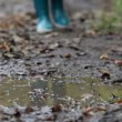 Rain boots walking in mud puddle and dirt in fall — Stock Video