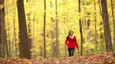 Autumn woman happy walking in fall forest — Stock Video
