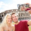 Tourist couple on travel in Rome by Coliseum — Stock Photo #32412455