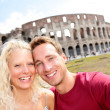 Tourist couple in Rome by Coliseum on travel — Stock Photo #32412479