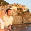 romantic couple in love by sunset in cinque terre — Stock Photo