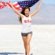 Winner athlete woman with american flag, USA — Stock Photo #32412527