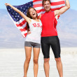 Cheering people athletes holding american USA flag — Stock Photo #32412593