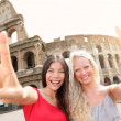 Travel tourist girl friends by Colosseum, Rome — Stock Photo