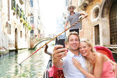 Couple in Venice on Gondole ride romance — Stock Photo