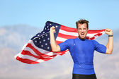 American success man athlete winning with USA flag — Stock Photo
